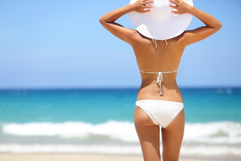 shutterstock 136004678 In je bikini op Insta: durven we dat echt allemaal?